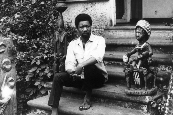 Akinwande Oluwole Soyinka, a lecturer in drama at the Ibadan University, although not a religious man, sits between a god and goddess at his residence in Ibadan, Western Nigeria, a week after he was released from detention for alleged involvement in the Nigeria crisis.    (Photo by Keystone/Getty Images)