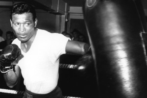 6 SEP 1962:  SUGAR RAY ROBINSON OF THE UNITED STATES IN ACTION PUNCHING A BAG DURING A TRAINING SESSION AT BLOOM's GYMNASIUM IN LONDON's WEST END BEFORE HIS FIGHT AGAINST TERRY DOWNES AT WEMBLEY ON SEPTEMBER 25. Mandatory Credit: Allsport Hulton/Archive