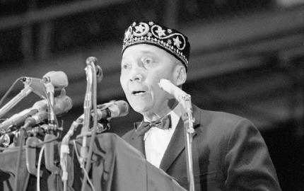 Original caption: 2/26/1966-Chicago, IL: Elijah Muhammad, 69, leader of the Black Muslims, speaks at the opening of the annual Black Muslim convention. February 26, 1966 Chicago, Illinois, USA