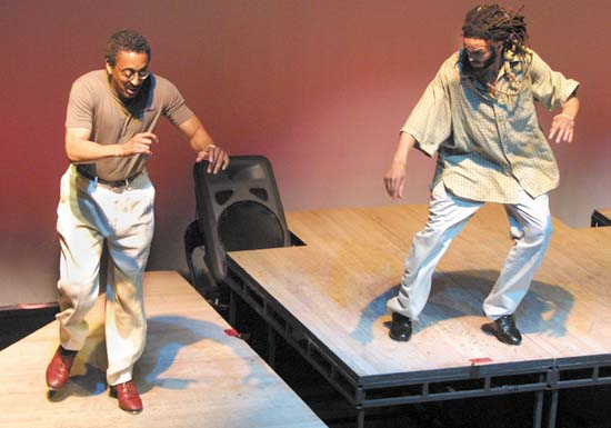 Gregory Hines, left, and Savion Glover perform during the New York City Tap Festival July 12, 2001 at The Duke Theater. (Photo by Mario Tama/Getty Images)
