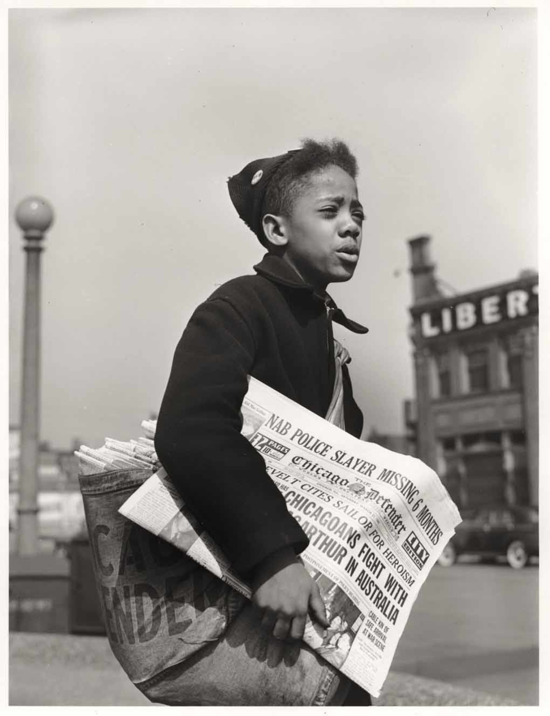 Newsboy selling the Chicago Defender, a leading Negro newspaper , April 1942. Photo by Jack Delano. Library of Congress LC-USW38-000698-D.
