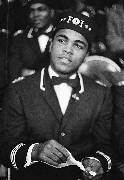Muhammed Ali, heavyweight champion sits at Black Muslim meeting in Chicago February 26, 1967, as Elijah Muhammed, leader of the religious sect addresses some 10,000 members of his sect in Illinois.   (AP Photo/Paul Cannon)