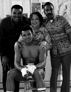 Family portrait of Muhammad Ali with (L-R) his brother Rahman Ali, his mother Odessa, and his father Cassius Clay Sr. during a photo shoot at his training camp cabin on 58 Sculps Hill Road.  Deer Lake, Pennsylvania 1/9/1974 (Image # 4030 )