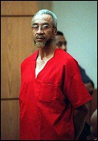 imam-jamil-in-red-prison-garb
