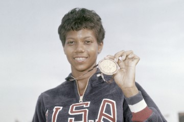 US athlete Wilma Rudolph shows the gold medal she won at the Women's 100 meters Summer Olympic Games sprint event on September 2, 1960 in Rome, Italy. (AP Photo)